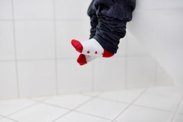 Close-up photo of toddler boy trainig use toilet