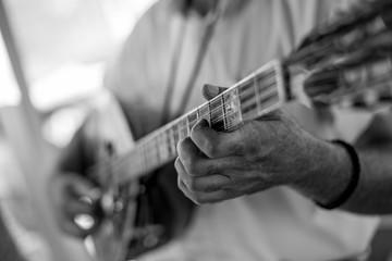Close up of man hand playing bouzouki