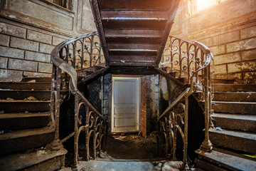 Rusty iron vintage stairs with rivets in the old abandoned mansion