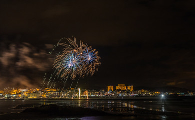 holiday in the Galician coast, where at night celebrating the festivities in the town of Foz, spain, we contemplate the fireworks worthy of admiration