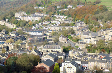 panoramic aerial view of the town of hebden bridge in west yorkshire showing the streets houses and old mill buildings set in the surrounding pennine valley woodland