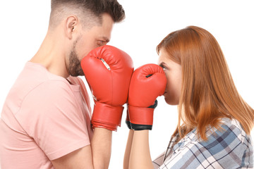 Angry couple in boxing gloves on white background