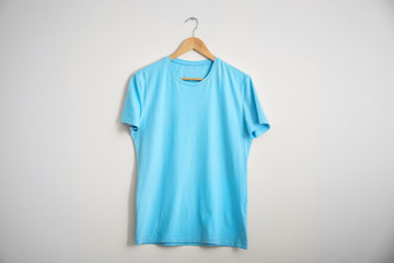 Color t-shirt on light background. Mockup for design