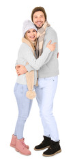 Young couple in warm clothing on white background. Ready for winter vacation