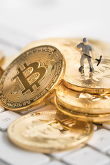 Bitcoin with little figure on keyboard