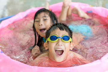 Foto op Aluminium Amusementspark Happy children in pink rubber pool, kids lifestyle concept.