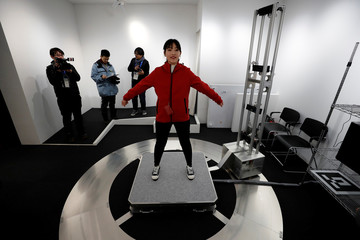 A visitor is scanned to add her images to an animation during the Tokyo 2020 Japan House media preview in Gangneung