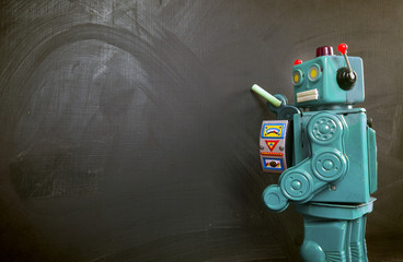Green robot teacher ot the blackboard