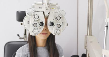 Asian Woman doing eye test