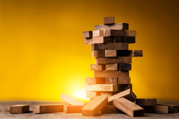 stack of wood block toy  with light flare on yellow background