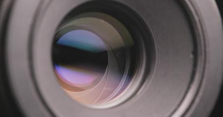 Camera lens adjusting aperture