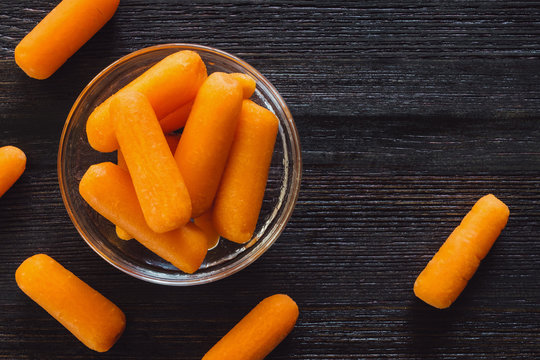 Baby Carrots on Dark Table