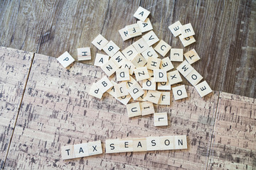 Tax Season Spelled out in Letter Tiles