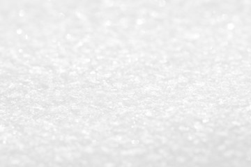 White shiny snow. Background with a texture of snowflakes.