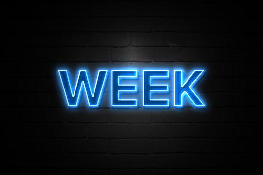 Week neon Sign on brickwall