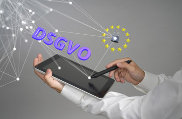 DSGVO, german version of GDPR. General Data Protection Regulation concept, the protection of personal data. Young man with tablet works with a virtual interface.
