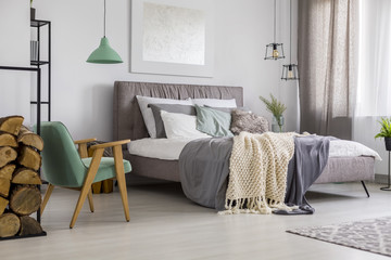 Green and grey bedroom interior