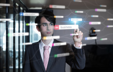 Business management concept. Young businessman pointing graphical user interface.