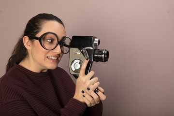 Young woman photographer wearing nerdy glasses