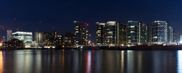 London, UK - Feb 7th, 2018: Inaugurated in Jan 2018, the new 518,000 sq foot, 12-story home of the United States Embassy in London at Nine Elms. Long-exposure night panorama overlooking River Thames,