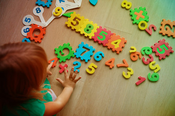 little girl learning numbers and math