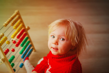 little girl playing with abacus, learning math