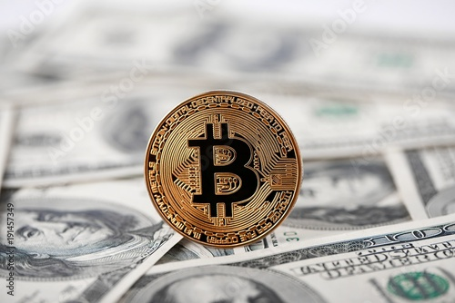 Shiny Golden Bitcoin Lying On Hundred Dollar Bills Presenting Gest Cryptocurrency And New Futuristic Form Of