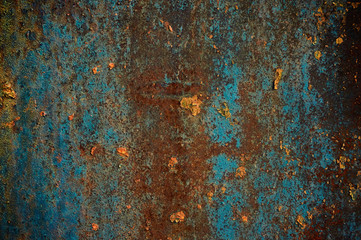 Rusty metallic surface blue paint.