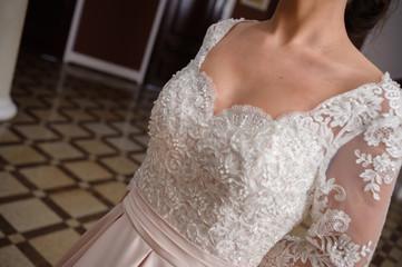 Beautiful bride in wedding dress interior
