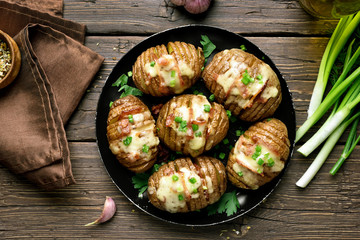 Baked stuffed potatoes with bacon, green onion and cheese