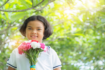 Asain cute girl is holding flowet bouquet in hand.children,kid,people
