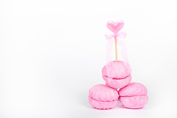 Pink marshmallows on white background. Raspberry souffle and pink heart. Romantic concept. St. Valentine's Day.