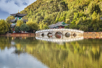 Suocui Bridge in the Jade Spring Park in Lijiang Old Town, China.