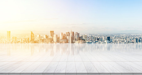 Business concept - Empty marble floor top with panoramic modern cityscape building bird eye aerial view under sunrise and morning bright sky of Tokyo, Japan, for display or montage product.