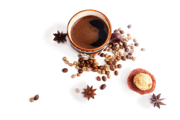 A cup of coffee, coffee beans, candy, anise. Isolate on white.