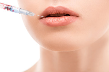 cropped view of girl doing beauty injection into lips, isolated on white