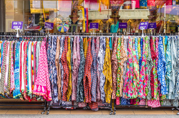 Various types of Indian fashion clothes displaying and selling in front of retail shop or store.