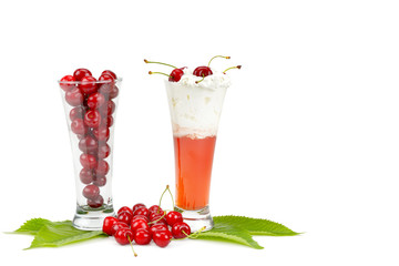 Fresh berries of cherries and smoothies isolated on white background.