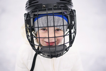 Portrait of a girl wearing an ice-hockey mask