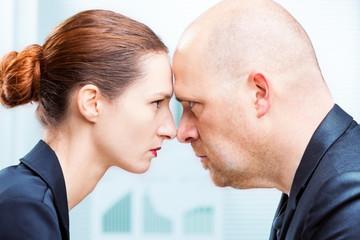 Man vs woman office confrontation