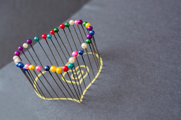 Heart shape from colored pins.