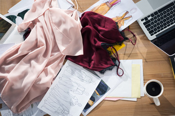 top view of messy fashion designer workplace