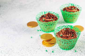 Chocolate cupcakes with green sugar sprinkles with copy space