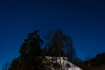 a night landscape photo shot in Austria at the half moon.