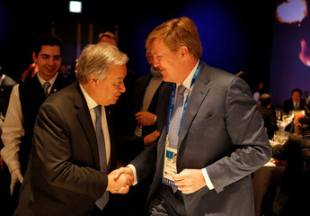 U.N. Secretary General Antonio Guterres speaks with Dutch King Willem-Alexander as they attend the President's Dinner on the eve of the Opening Ceremony for the Pyeongchang 2018 Winter Olympics in Pyeongchang