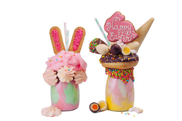 Tuinposter Milkshake Two Easter freak shakes decorated with Easter bunny gingerbread isolated on white background