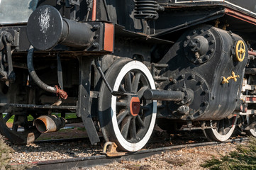 Steam train locomotive close up on wheels and pressure gauge