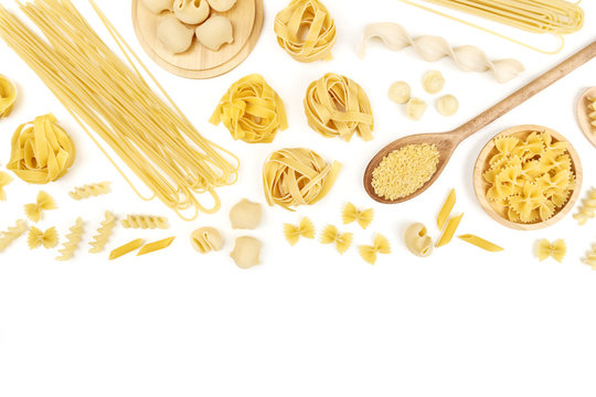 Overhead photo of different types of pasta on white with copy space