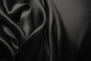Elegant black satin silk with waves, abstract background Wall mural