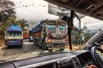 Wall Murals Nepal Trucks and Buses Crawling on Prithvi Highway, Nepal